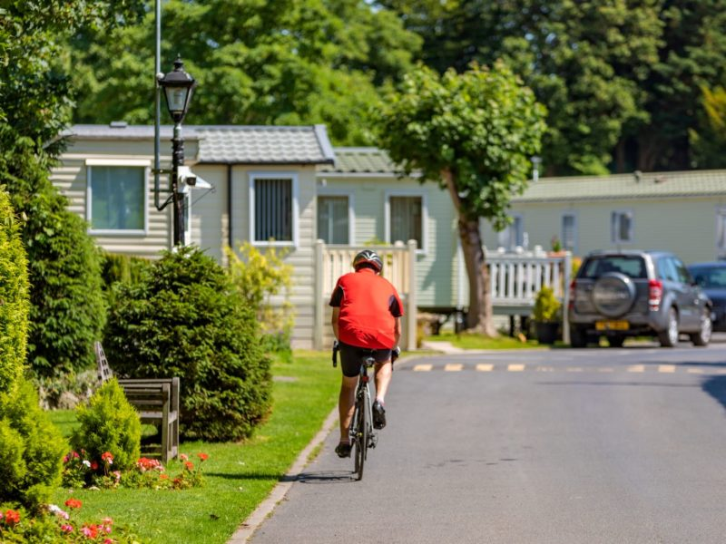 Man cycling through Mowbreck Caravan Park near Blackpool