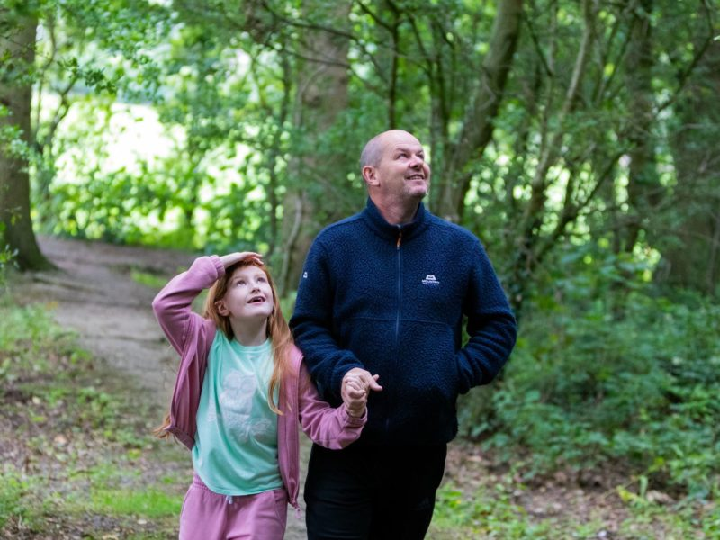 Father and daughter walk near Fylde Coast caravan park